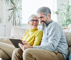 Elderly couple looking at laptop