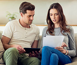 Young couple researching finances
